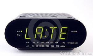 radio-di-orologio-con-la-parola-ritardo-17963880