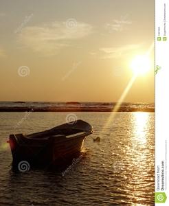 barca-sul-mare-al-tramonto-1367339